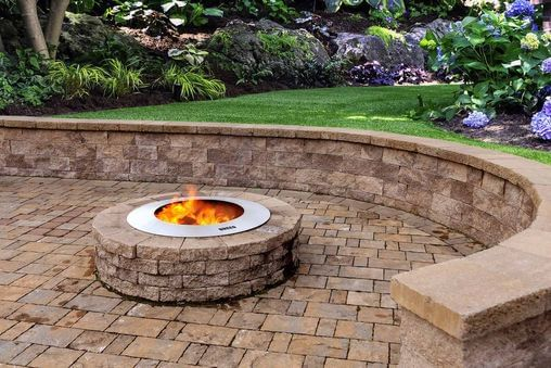 Zentro Stainless Steel Smokeless Fire Pit Insert with block surround on paver patio