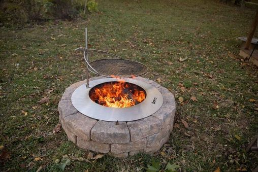 Breeo stainless steel zentro smokeless fire pit insert and outpost grate with block surround in backyard