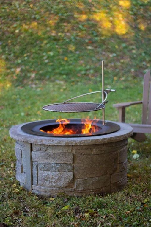 black zentro smokeless fire pit insert in stone fire pit with outpost grate