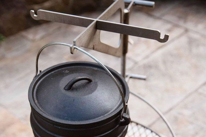Black Kettle hanging from stainless steel kettle hook