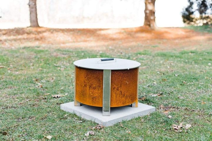 Corten fire pit with the X Series lid on it