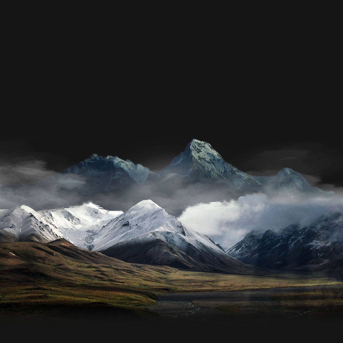 Grand landscape image with rolling hills and snowcapped mountains
