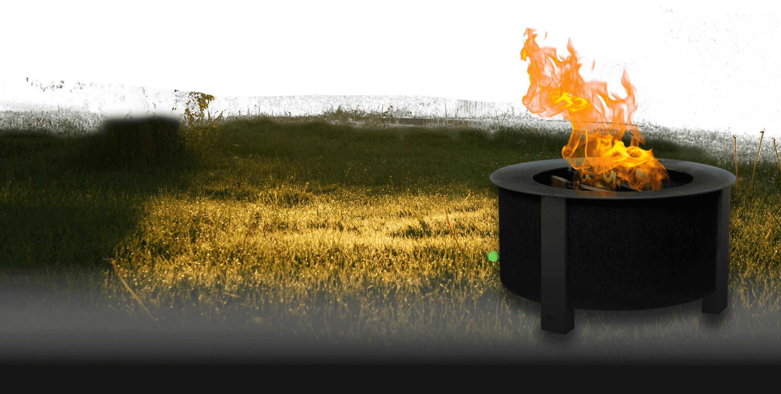 Firepit on golden lit grass