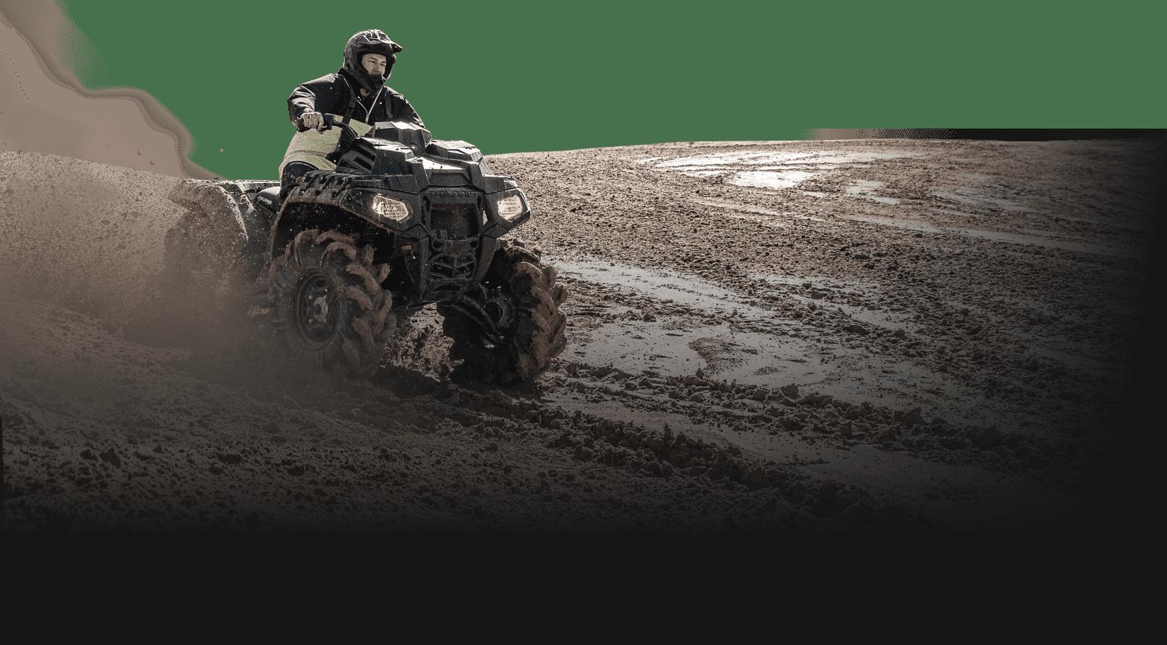 Man riding ATV in the mud