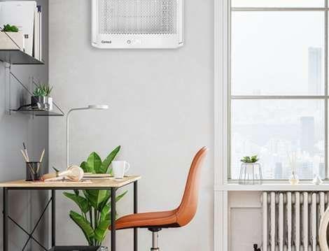 ar-condicionado mais silencioso com cadeira e mesa em uma sala