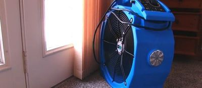 Fan set up during a bedbug heat treatment